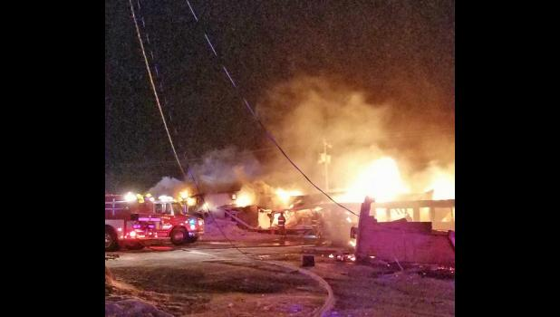 Crews work diligently to put out the early morning motel fire.