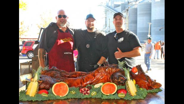 Even in the world of competitive barbecue, this is a masterpiece. Bob Stanfiel, left, organized the six various volunteer chefs to prepare two donated hogs and 560 pounds of beef brisket.