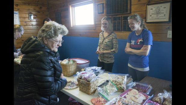 A bake sale fundraiser for the gymnastics program was held during the home games Saturday, February 10.