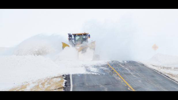 Meade County crews worked to clear drifts back from the highway to prevent more blowing and drifting. Even without fresh snowfall, drifts left too close to the road can cause travel problems when the wind moves the snow.