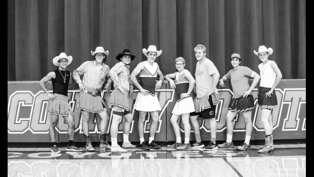 Homecoming week cheerleaders for the Lady Coyotes' volleyball team at the game in Murdo against the White River Tigers. Left to right; Slade Benedict, Dylan Fuoss, Chase Barnes, Wyatt Olson, Garret Hatheway, Ty Fuoss,  Tanner Willert, and Bridger Hight. Way to stoke up some school spirit, guys!