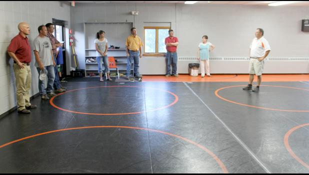 The school board toured the new wrestling practice room, which will also be used for some physical education classes. It takes its place in the old library. The new library is in room A-1, the old computer lab. The new computer lab is in room A-3, next to the high school offices. Also, the refurbished locker rooms are being repainted and carpeted.