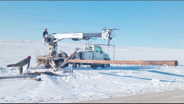 A private contracting crew from Reva, was called in to help restore power by putting in new poles along the Stoneville Road north of Union Center. Crews battled deep snow as they worked to repair downed lines.