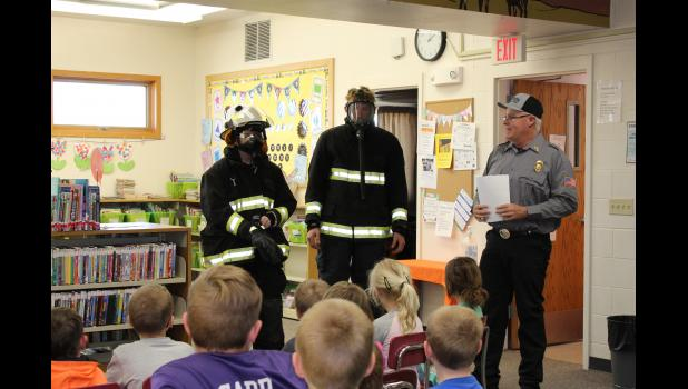 Fire Chief Justin Haines … sharing fire extinguisher best practices with students.
