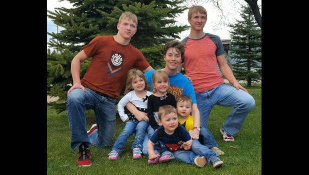 Jill Archibald with the 3 sets of twins she has cared for in the past 20 years. left to right, Cole and Cody Buer, Baelyn and Tegan Senn, Jacob and Liam Kruger. There is no end in sight when it comes to Jill and taking care of Bison's babies.