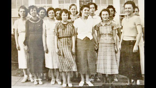 The New Underwood Girls' Athletic Association of 1936 pose in front of the school. Back, l-r: Doris Fernau, Phyllis Hofer, Darlene Burchard, Lucille Wallis, Inez Hofer, Bernice Reed, LaValle Burchard. Front, l-r: Louella Storm, Vera Walthall, Natalie Swanson, Arlene Morey, Amy Kopp, Miss Muriel Hebbert.