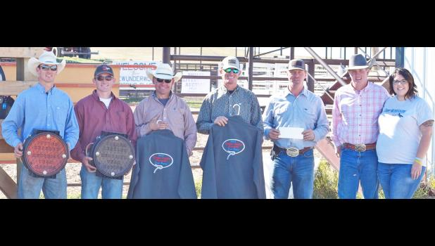 Winners of the roping event were the team of Trevor Hupp and Dalton Richter, in second were Troy Richter and Jake Nelson, third were Levi Hapney and Jake Nelson (not pictured). At right are Dylan and Anna Keszler.