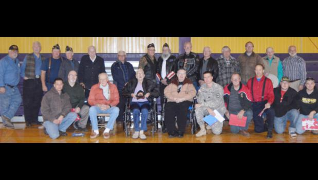Four of the five branches of the U.S. military were represented at the New Underwood Veteran's Day celebration. Back row from left are Buzz Johnson, Army, Don Krog, Air Force, Ron Racicky, Navy, Wes Reeves, Army National Guard, Melvin Fernau, Army, Gene Crosbie, Army National Guard, Ken Karp, Army, Chuck Dockter, Army, Bill Winegar, Army, Don Weibers, Army, Dennis Anderson, Navy, Casey Tippmann, Army, Ronald Miller, Army and Larry Broomfield, Air Force. Front row from left are Matthew Emmons, Air Force, Dav