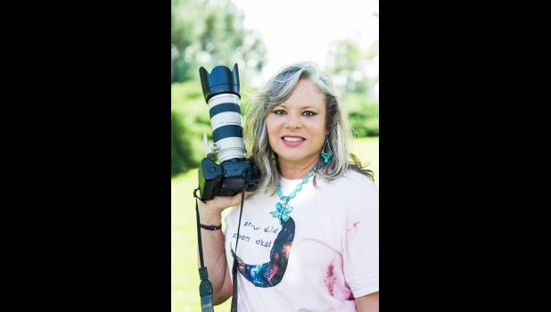 Pictured is photographer Barb Hockenbary. Her and her husband, Jim, own and operate Corky's Auto Supply in Murdo, SD.