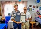 "Butch Feddersen presents Bob Totton with the Governor's Proclamation designating August 4, 2016 as ""Bob Totton Day."""