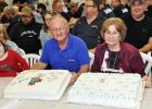 Alvin and Ruby Pearson with two cakes commemorating Alvin's 45 years at Scotchman Industries, Inc.