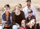 The Switzer family has moved to Midland. Pastor Walter is the new Open Bible Church pastor. Shown in back is Pastor Walter. In the middle, from left, are Caleb (12), Darcey and Seth (9). Front: Zoey (4) and Abigail (7).